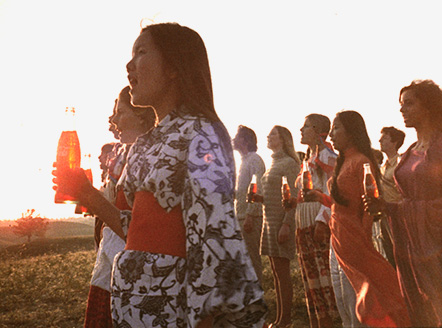 The vintage 'Hilltop' Coca-Cola ad, blatantly appropriating the hippie subculture while removing its underlying political motivation.